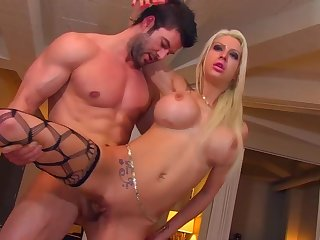 Blonde hooker Lexxxy Knockout with big fake tits gets a cumshot