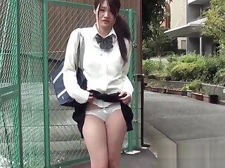Mesmerizing Japanese schoolgirl has a vibrator in their way pants