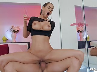 Erotic pornstar Desiree Dulce having carnal knowledge with a dildo and a dick