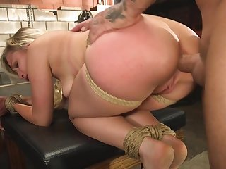 Surprising light-complexioned girl is tied and fucked in the basement