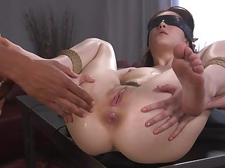 Helpless girl is tied, blindfolded and fucked anent the ass